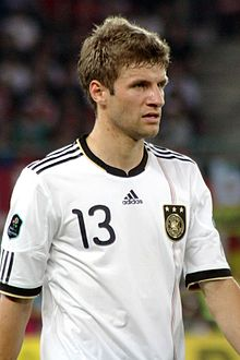 Thomas Müller standing on a field