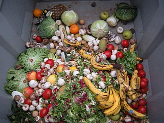 Food waste - Fruit and vegetables in a dumpster, discarded uneaten