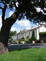 Tudor Road, Newton Abbot Taken from the inside of the sharp bend on Powderham Road mentioned in 497585. Tudor Road branches off here and itself drops steeply towards East Street and the town centre.