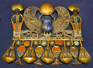 Exhibitions of artifacts from the tomb of Tutankhamun - A pectoral belonging to Tutankhamun, representing his Prenomen.