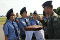 U.S. Air Force Lt. Col. Brian Peterson, right, participates in a traditional Ukrainian custom of taking a piece of bread after landing at Mirgorod Air Base, Ukraine, July 17, 2011, as part of Safe Skies 11 110717-F-VM486-673.jpg
