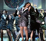 U.S. Air Force Tops in Blue members performing on stage at Aviano AB, Italy 041023-F-RO738-014.jpg