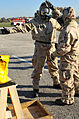 U.S. Airmen with the 375th Air Mobility Wing decontaminate each other with M295 individual equipment decontamination kits at a contamination control area during an operational readiness inspection preparation 091105-F-GC775-067.jpg