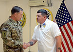 U.S. Army Maj. Gen. William C. Mayville Jr., left, the commanding general of the 1st Infantry Division and the International Security Assistance Force Combined Joint Task Force 1, congratulates Jeffrey Creaser 121228-A-RW508-002.jpg