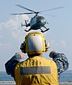 U.S. Navy Boatswain's Mate 2nd Class Carlos Medina guides an Indonesian navy Bo105 helicopter during flight operations aboard the guided missile destroyer USS Momsen (DDG 92) in the Java Sea May 24, 2013, during 130524-N-YU572-089.jpg