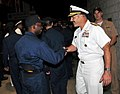 U.S. Navy Rear Adm. Mark D. Guadagnini, foreground right, deputy commander with fleet management and chief of staff of U.S. Fleet Forces Command, congratulates a recruit following a capping ceremony at Recruit 120817-N-IK959-170.jpg