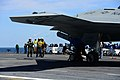 U.S. Sailors aboard the aircraft carrier USS George H.W. Bush (CVN 77) remove the chocks from a Navy X-47B Unmanned Combat Air System demonstrator aircraft May 14, 2013, in the Atlantic Ocean 130514-N-TB177-462.jpg