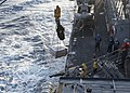 U.S. Sailors aboard the guided missile destroyer USS Stout (DDG 55) receive a load of supplies from the fleet replenishment oiler USNS Leroy Grumman (T-AO 195), not shown, during a replenishment at sea in 131002-N-UD469-450.jpg