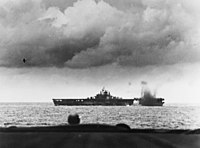 USS Bunker Hill (CV-17) is near-missed by a Japanese bomb during the Battle of the Philippine Sea, 19 June 1944 (80-G-366983).jpg