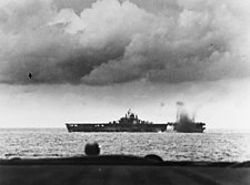 USS Bunker Hill (CV-17) is near-missed by a Japanese bomb during the Battle of the Philippine Sea, 19 June 1944 (80-G-366983)