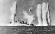 USS Edsall (DD-219) under fire and sinking on 1 March 1942 (80-G-178997)
