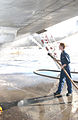 US Navy 021028-N-2468S-002 Sailors must wash down station aircraft to remove volcanic ash.jpg