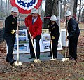 US Navy 022208-N-3312P-001 Rear Adm. Mark S. Boensel, left, commander, Navy Region Mid-Atlantic, helps break ground for the new 4,300-square-foot community center at Lincoln Military Housing.jpg