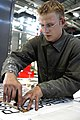 US Navy 040816-N-0683J-040 Aviation Support Equipment Technician 3rd Class Dave Bonly assigned to the aircraft carrier USS Carl Vinson (CVN 70), creates labels for recently reworked aviation support equipment at Naval Station E.jpg