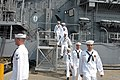 US Navy 040930-N-4397B-004 Sailors assigned to the guided missile cruiser USS Ticonderoga (CG 47) depart the ship for the last time, as Ticonderoga is decommissioned.jpg