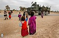 US Navy 050124-N-1810F-617 Iraqi children wave to an American convoy that passes on a local road.jpg