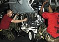US Navy 050201-N-8539M-014 Aviation Ordnanceman 3rd class Jeremy Biddle of Phoenix, Va., and Aviation Ordnanceman Airman Timothy Wilson of Norfolk, Va. remove the 20mm M61A1 Vulcan gatlin gun from an F-A-18C Hornet.jpg