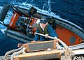 US Navy 050612-N-9860Y-006 Boatswain's Mate 3rd Class Michael R. Campbell climbs the Jacob's Ladder into a mooring station aboard USS Blue Ridge (LCC 19) after embarking on the Royal Australian Navy auxiliary oiler replenishmen.jpg