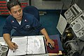 US Navy 050619-N-1332Y-037 Machinery Repairman 1st Class Julius Rodriguez stands watch as Damage Control Petty Officer of the Watch (DCOW) aboard the conventionally powered aircraft carrier USS Kitty Hawk (CV 63).jpg
