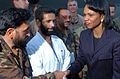 US Navy 051012-N-8796S-402 U.S. Secretary of State Condoleeza Rice shakes hands with a member of the Pakistani military during a visit to the Pakistan Air Force Base in Chaklala, Pakistan to witness multinational relief efforts.jpg
