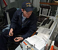US Navy 060323-N-7092S-036 Gas Turbine System Technician Fireman Michael Seabolt lays out his tools for a spot check aboard the guided-missile destroyer USS McFaul (DDG 74).jpg