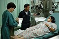 US Navy 060529-N-3931M-031 Navy Hospital Corpsman Mark Almario translates while Mary Herlihy, an obstetrician- gynecologist from Project HOPE.jpg