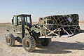US Navy 061219-N-3067W-041 Electronics Technician 3rd Class Daniel Yepez, assigned to Navy Cargo Handling Battalion One (NCHB-1) Cargo Transfer Platoon, drives a 10K forklift to transfer a pallet of tires to a staging area at A.jpg