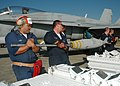 US Navy 070309-N-7427G-002 Ordnance departments assigned to Strike Fighter Squadron (VFA) 204 and Naval Air Station Joint Reserve Base, New Orleans, ready bombs for attachment onto an F-18 during a recent training exercise hos.jpg