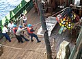US Navy 071105-N-0000X-009 U.S. Navy Sailors help load lube oil onto Manuvo I prior to it getting underway.jpg