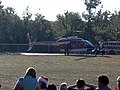 US Navy 071221-N-8240P-001 Bypassing the traditional red sleigh, Santa visited Bennett C. Russell Elementary School, in style with the help of a TH-57 Sea Ranger Helicopter.jpg