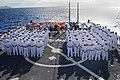 US Navy 080114-N-5476H-046 Sailors stand in ranks during a change of command ceremony on the flight deck of the Arleigh Burke-class guided-missile destroyer USS Russell (DDG 59).jpg