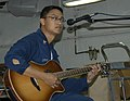 US Navy 080906-N-4680O-032 Storekeeper 1st Class Ronneil Capones plays guitar during a.jpg