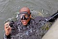 US Navy 090329-N-2383D-007 Explosive Ordnance Disposal Technician 1st Class Jeremy Starks, assigned to the forward-deployed U.S. Navy Explosive Ordnance Disposal Mobile Unit 2, surfaces after completing a dive into Africa's Lak.jpg
