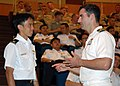 US Navy 090619-N-5207L-040 Republic of Singapore Navy Maj. Rinson Chua speaks with Lt. Cmdr. Greg Adams of Commander.jpg