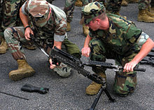 US Navy 091002-N-9261G-022 Seabees assigned to Naval Mobile Construction Battalion (NMCB) 133 assemble an M-240B machine gun during the Black Hell Squad.jpg