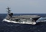 US Navy 100227-N-4408B-613 USS George H.W. Bush (CVN 77) heels hard to starboard during high-speed drills.jpg