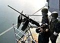 US Navy 100324-N-5386R-117 Sailors man a .50 caliber machine gun on the fantail aboard USS Abraham Lincoln (CVN 72).jpg