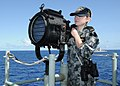 US Navy 100620-N-3327M-005 Able Seaman Communication Information Systems Operator Kaitlin Clohesy, assigned to the Australian navy guided-missile frigate HMAS Newcastle (FFG 06), demonstrates flashing light signals.jpg