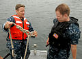 US Navy 100729-N-2218S-037 Chief Boatswain's Mate John Tredway shows Master-at-Arms 3rd Class Hull Rohde how to tie a knot.jpg