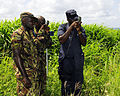 US Navy 100811-N-9643W-449 Members of the Barbados Defense Force search for pre-placed points during the land navigation portion of the Marine Corps subject matter expert exchange.jpg