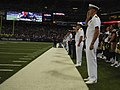 US Navy 100902-N-3541A-125 Sailors salute during the playing of the National anthem before a St. Louis Rams pre-season football game during St. Louis Navy Week Navy Week 2010.jpg