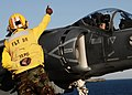 US Navy 100914-N-7508R-166 Sailor gives thumbs up to pilot.jpg