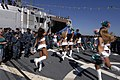 US Navy 101109-N-5700G-080 Miami Dolphins cheerleaders perform for the Sailors aboard the guided-missile destroyer Pre-Commissioning Unit (PCU) Jas.jpg