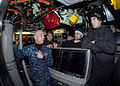 US Navy 101214-N-7179M-063 Lt. Ryan M. Hofer ives a tour of the control room to players from the Norfolk Admirals hockey team.jpg