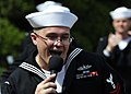 US Navy 110406-N-RO948-104 Musician 2nd Class Charles Perks sings as the U.S. 7th Fleet Band performs at a city park while on tour in the Republic.jpg