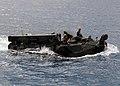 US Navy 110924-N-WJ771-041 Marines assigned to the 31st Marine Expeditionary Unit (31st MEU) pilot an amphibious assault vehicle.jpg