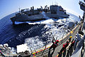 US Navy 111027-N-KM175-019 Gunner's Mate 2nd Class Davis Harris, left, fires a shot line to the Military Sealift Command dry cargo and ammunition s.jpg