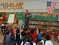 US Navy 111110-N-YU572-111 Naval Air Crewman 1st Class Scott Barrow speaks to students at St. Theresa Catholic School about his naval career.jpg