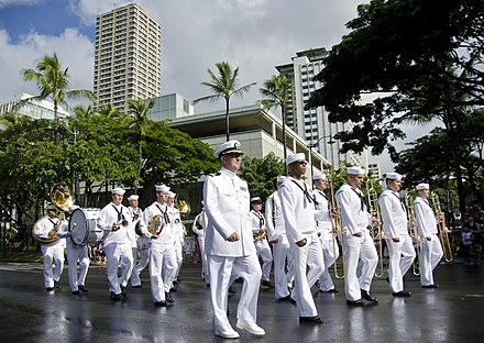 The U.S. federal government's spending on Hawaii-stationed personnel, installations and materiel, either directly or through military personnel spending, amounts to Hawaii's second largest source of income, after tourism. US Navy 111218-N-RI884-097 The U.S. Pacific Fleet Marching Band participates in a parade through downtown Waikiki honoring Japanese-American vetera.jpg