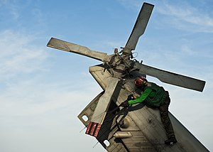 US Navy 120105-N-BT887-644 Airman Joyce Cruz secures a tail rotor of an MH-60R Sea Hawk helicopter from the Raptors of Helicopter Maritime Strike S.jpg